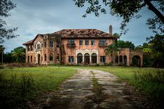 Howey Mansion by Sky Noir Once the mansion of the 1920's citrus tycoon William John Howey. In now sits abandoned and deteriorating in central Florida just outside the town he founded. Howey-in-the-Hills, Florida USA