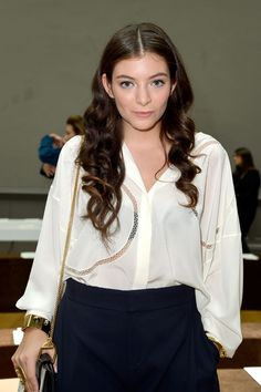 Lorde with lightened-up makeup and loose curls