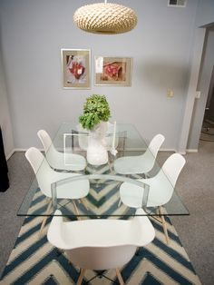 Blue chevron rug, glass top table, eames shell chairs.  Emily Henderson