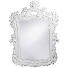 This large rectangular mirror has an ornate frame detailed with a feathery scrolling design. Details: - Collection: Turner - Shape: Rectangle - Ship Via FedEx: No - Materials: Resin Dimensions: - Over