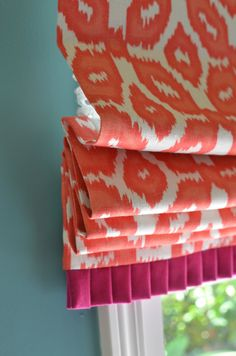 Cute roman shade with bottom pleat detail, but that color combination?!?
