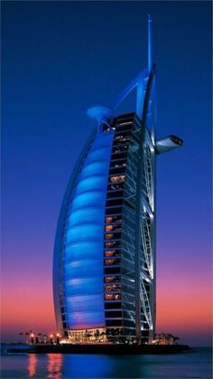 Amazing Burj Al Arab, Dubai-I have happy memories of watching the Burj change colors while we rode the waterslides at Wild Wadi Waterpark Burj Al Arab, Amazing Buildings, Amazing Architecture, Places To Travel, Places To See, Beautiful World, Beautiful Places, Photos Du, Dream Vacations