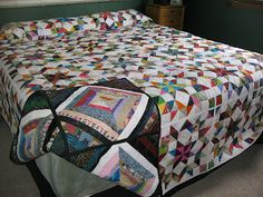 Buggy Wheels on one side, string quilt on back; quilt as you go.  MooseStash Quilting