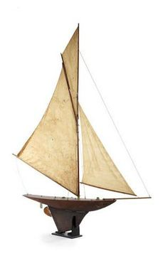Gladys, a large Victorian straight line pond yacht.