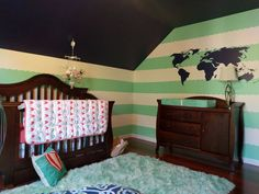Have a travel theme Nursery? This WallQuotes vinyl world map is the perfect wall art!