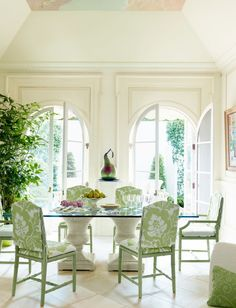 July / August 2013 US House Beautiful Review crips clean white breakfast room with rounded window frames
