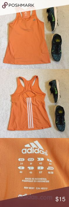 Nike workout racerback top retro size small Adidas workout top Excellent condition Size medium  Racer back with cut out in the back along with the classic Adidas stripes Feel free to make me an offer I have a bundle discounts if you like more than one thing from my closet And I have a lot of work out gear 💖💖 adidas Tops