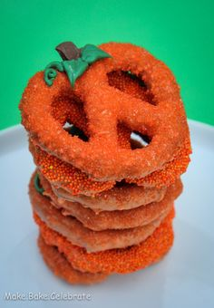 Chocolate Covered Pumpkin Pretzels - i will take the pretzels, orange candy melt, orange sprinkles and pre-made leaves to preschool class - kids can dip top of pretzels in micro-melted candy, sprinkle on sugar and add the leaves themselves.... doable by kidlets..