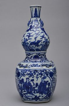 Ming period. The vase is double-gourd shaped. The exterior is decorated with numerous scholars socializing, birds and dragons flying, and ruyi clouds. 17 1/2in. tall.