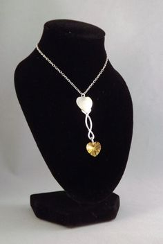 This Pendant has been inspired by Welsh lovespoons. The double heart represents reciprocated love and the twisted stem symbolises togetherness.