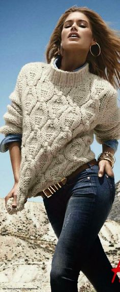 I love the cables in this sweater and the reverse stock sleeves. I'm always intrigued by a chunky sweater that is 'working'.