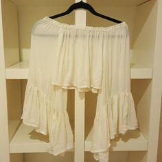 Indah Crop Top Semi-sheer off the shoulder crop top with cute ruffle sleeves detailing.  Like-new condition.  No flaws.  Fits like the last picture, but the color is like the first three pictures. Indah Tops Crop Tops