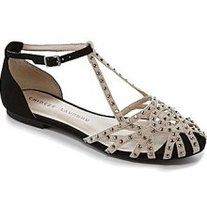 This flat features: strappy, rhinestone-encrusted suede upper, adjustable ankle strap with buckle closure for a custom fit, synthetic lining, rubber outsole.