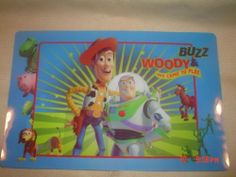 """Toy Story Placemat by Disney/Pixar. $2.49. Placemat Measures 11"""" x 17"""". Helps Protect Your Table and Limit the Mess. Made of a Durable Plastic. Easy to Clean, Just Wipe it off. This Placemat Features a Large Version of WOODY and BUZZ LIGHTYEAR and features many of the other Characters from the Movie around the trim of the Placemat. Bright Colors."""