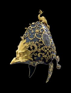 """Pomp Helmet. I don't think I've ever heard myself think """"This reminds me of the holocaust"""" and then followed it up with """"in the best possible way!"""" I don't know... It looks like an imperial germanic helmet from some sort of romanticized operatic 16th century historical fantasy. It gives me ideas, crappy writing ideas :D"""