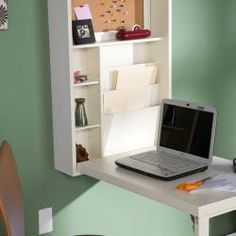Make the most of a compact room with this Murphy convertible desk from Upton Home. The desk folds out from the wall-mounted cupboard, creating a convenient work area whenever you need it. Space Saving Storage, Small Storage, Fold Out Table, Desk Dimensions, Desks For Small Spaces, Diy Fireplace, Fireplaces, Office Nook, White Office