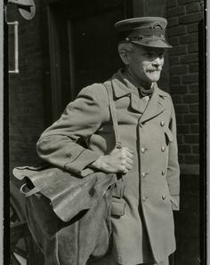 Early 1900s mail carrier in New York City. (Courtesy of the NYPL)