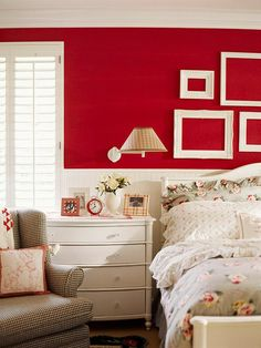 pull 1 statement making color out of bedspread fabric for wall color: candy apple red walls are bold. painted picture frames white and left empty on wall above bedframe. white pops against red = contrast added Bedroom Red, Small Room Bedroom, Home Decor Bedroom, Bedroom Color Schemes, Bedroom Colors, Red Rooms, Red Walls, Living Room Paint, Room Themes