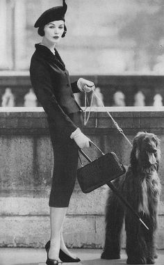 September Vogue 1956 by Karen Radkai    Model is wearing a Lilli Ann suit