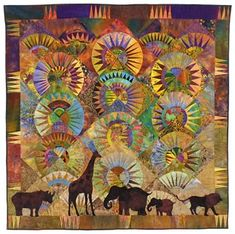 Beautiful quilt with animals appliquéd on a paper pieced background.