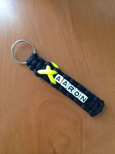 Awareness Ribbons with name/black keychain - Honor, Remember and Support your loved one - 550 Paracord keychain