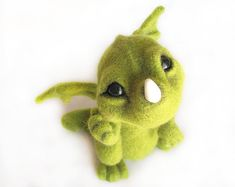 Needle Felted Toy - Little Green Dragon  It is small and quite harmless. Dragon will please you and bring good luck.  He is needle felted from natural
