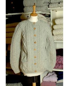 Made from 100% pure wool, this traditional Irish Fisherman's Style Cardigan, has been specially handknitted for us in South West Donegal. Exceptionally high quality craft work.  Our knitters draw on a lifetime of experience using ancient patterns and skills passed down from generation to generation. Each garment is unique and features the individual knitter's personal pattern choice and interpretation of a classic Aran fisherman's sweater.