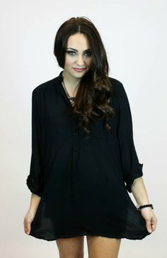 This simple black tunic is perfect for leggings, jeans, workk, hanging out, or however you.
