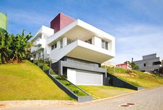 Diverse Modern Architecture Originally Adapted to a Steep Site  #architecture