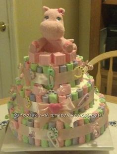 Coolest Edible Diaper Cake for a Baby Shower... This website is the Pinterest of birthday cake ideas