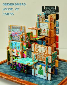 This is a Gingerbread House of Cards based on the Eames card deck. Each piece was created by a different  cookie artists!! Take a look at it as it is quite amazing!!! Mighty Delighty: Gingerbread House of Cards Collaboration
