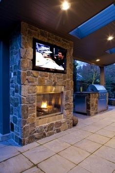 outdoor tv, fireplace and grill.