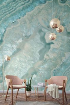 """Want to know what a """"girl cave"""" looks like? This crystal wallpaper and those blush pink armchairs are a match made in heaven! Stunning tones and a myriad of layers in this wall mural have an almost hypnotic effect. Perfect for modern living room spaces looking for a girly touch. #wallpapermuralsspace #wallpapermuralsmodern"""