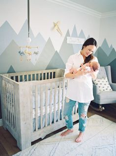 blue and gray nursery with a mountain mural More