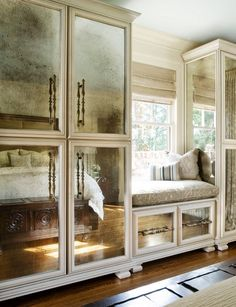 I'd consider these cabinets with antiqued mirror panels. Very glamorous, Hollywood. It would also bounce light around, which is usually welcome in a closet.