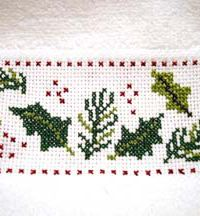 <p> Cross stitch a pair of tea towels: Holly and Lights.</p> - FREE pattern instructiions
