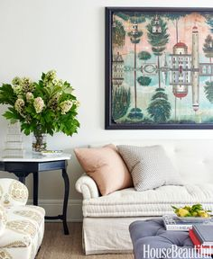 A painting by Kevin Paulsen inspired the living room's softly exotic palette. For casual appeal, Eliza Dyson had the sofa's seat cushion made in the style of a French mattress. The chair is in Raoul Textiles' Fig. The walls are painted in the designer's favorite neutral, Farrow & Ball's Skimming Stone.