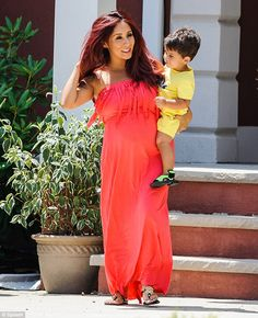 Bright outlook: Seven months pregnant Snooki steps out in New Jersey with her son Lorenzo in tow wearing an orange maxi dress http://dailym.ai/1zqMm9M