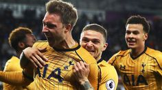Christian Eriksen celebrates scoring Tottenham's third goal at the Liberty Stadium