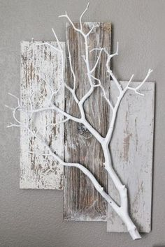 pallets and White branch. Very cute idea for plants or other things to hang