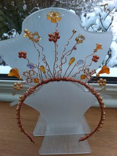 My first Tiara using rose gold copper toned wire peach and orange toned beads flower beads fix pearls crystals and glass beads