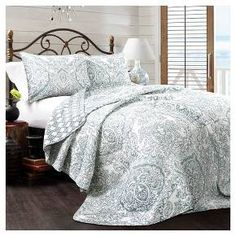 We took very traditional damask and paisley patterns and combined them into one beautiful and interesting 100% cotton quilt with a modern feel. The reverse side features a geometric pattern for those who are looking for a more contemporary look.