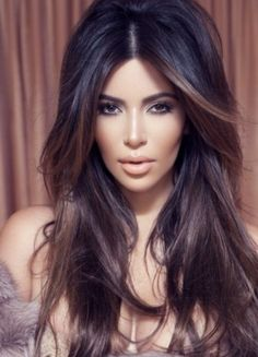 Kim Kardashian's big hair. Her hair is always beautiful. Love the brown in the front!