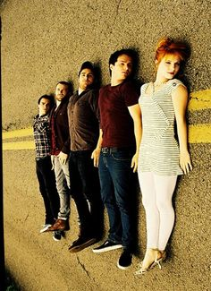 band lying in road - Google Search