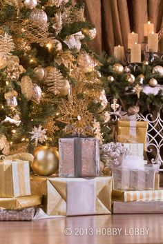 Sparkling silver and glittering gold wrapping make gifts stand out under the tree.