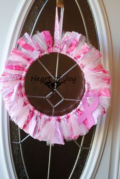 $35.00 Pink and white tulle and fabric wreath with pink foam Breast Cancer embellishment www.facebook.com/myheartofjoy heartofjoycreations@gmail.com
