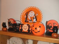 Some vintage Halloween treat pails and a lovely Halloween tin platter.