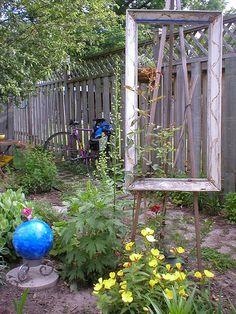 Picture frame artist easel as garden art