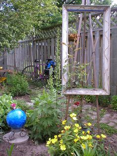 Picture frame artist easel as garden art