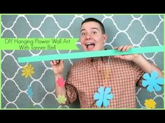 Watch and learn how to make this DIY Hanging Flower Wall Art that is perfect for any teen girl's room decor by Tanner Bell for Sizzix!